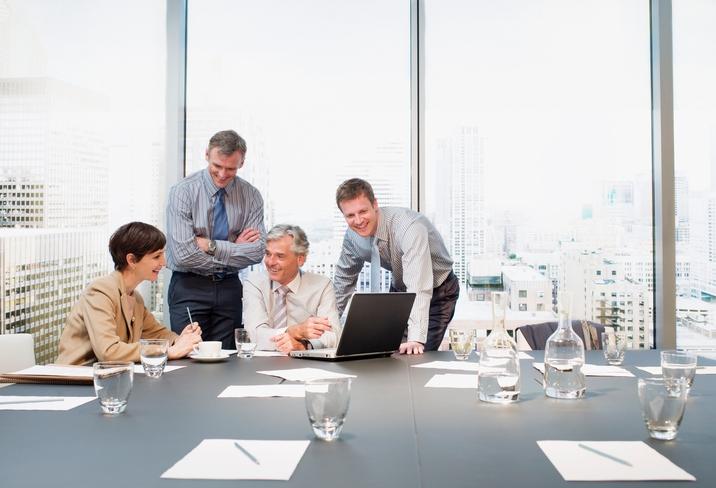 4 people in board room